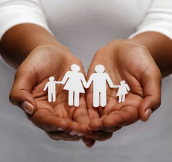 stock-photo-life-insurance-love-and-charity-concept-closeup-of-womans-cupped-hands-showing-paper-man-family-426813454.jpg