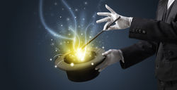 stock-photo-magician-hand-conjure-with-wand-light-from-a-black-cylinder-1238288824