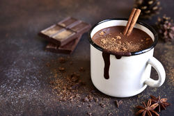 stock-photo-homemade-spicy-hot-chocolate-with-cinnamon-in-enamel-mug-on-a-slate-stone-or-concrete-background-668516281.jpg