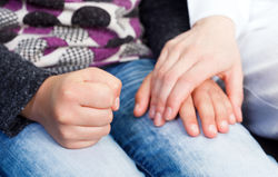 stock-photo-photo-of-young-doctor-hand-on-the-childs-hand-255894823.jpg