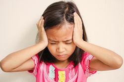 stock-photo-portrait-of-preschooler-girl-having-a-headache-326115887.jpg